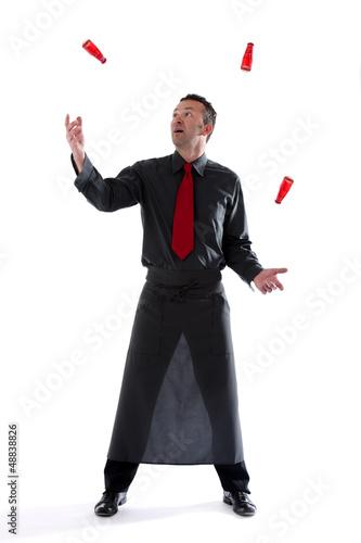 Bartender juggling bottles