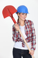 Female construction worker with a shovel