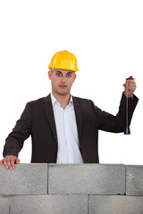 Man checking wall is level