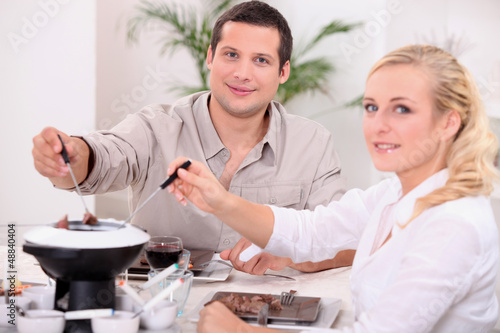 Couple enjoying a chocolate fondue
