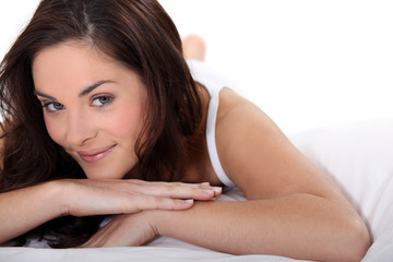 Smiling woman on a bed