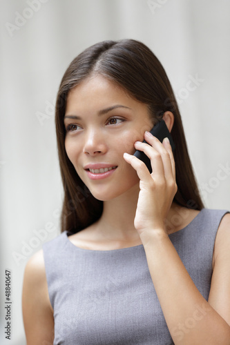 Business woman lawyer talking on smartphone