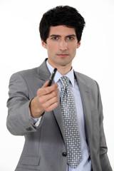 Businessman offering pen
