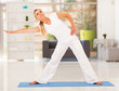 healthy mature woman doing exercise at home