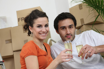 Couple celebrating purchase of first house together