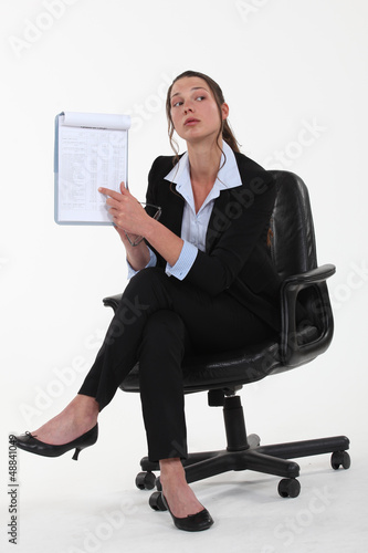 Businesswoman pointing to a list