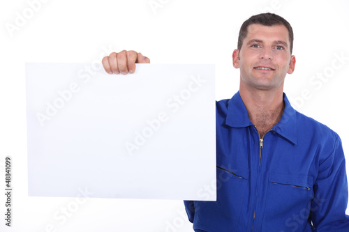 man showing a piece of paper