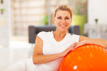 healthy senior woman portrait with exercise ball