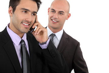 young businessman talking on his cell