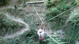Senior man navigating a rope suspension bridge