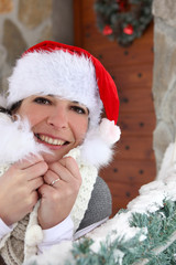 Woman in festive hat stood with decorations