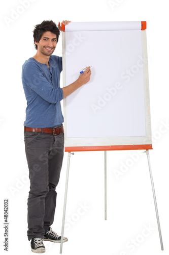 Man writing on a flipchart