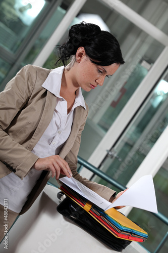 young businesswoman looking at her documents