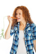 redhead eating a carrot