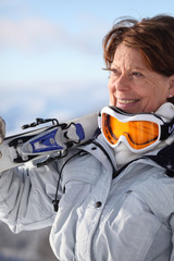 Mature female skier