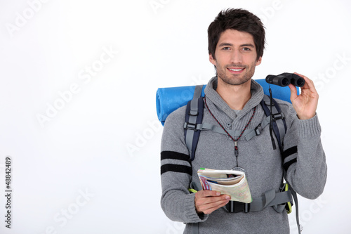 Backpacker with pair of binoculars