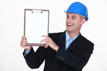 Happy man holding clip-board
