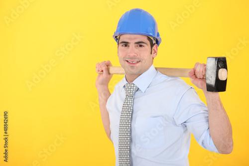 Builder holding hammer
