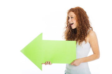 Excited woman holding an arrow pointing left