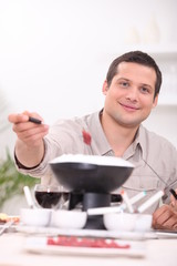 Man with fondue
