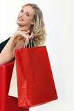 Woman sat holding shopping bags