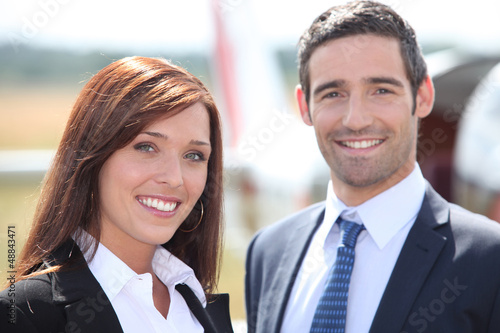 Couple in front of airplane