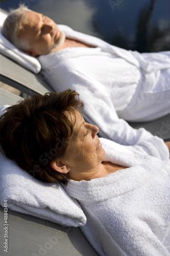 senior couple on vacation wearing bathrobes