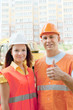 two happy builders in hardhat