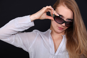 Woman adjusting her sunglasses