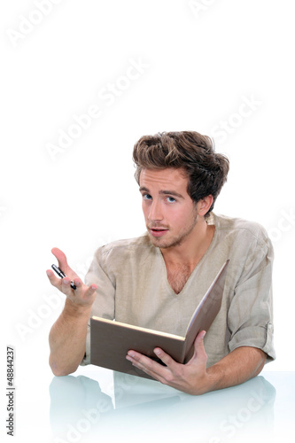 Man writing in a journal
