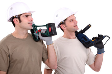 Men holding power tools