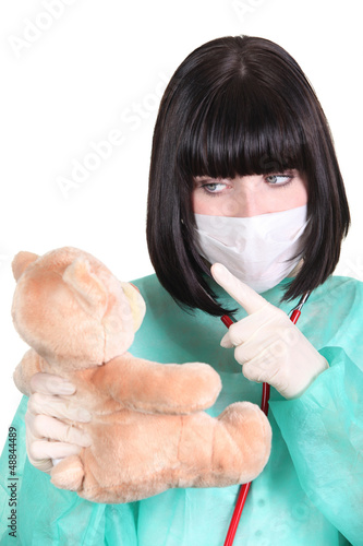 Surgeon admonishing a teddy bear