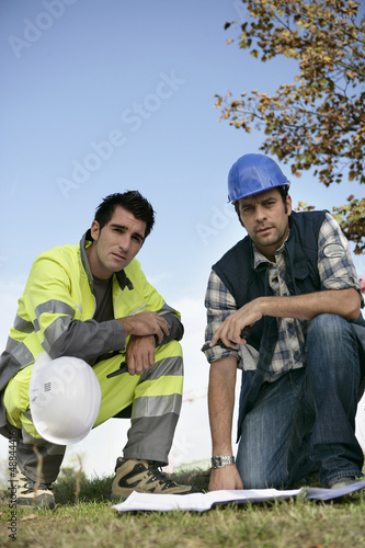 technicians studying a working project