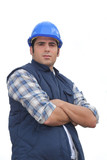 Portrait of a standoffish tradesman with his arms crossed