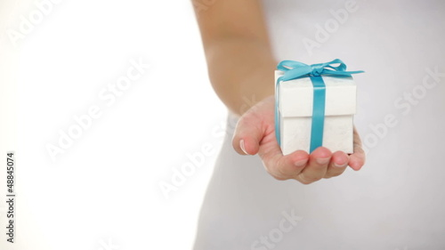 Present or gift box in female hands