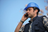 Foreman talking on his mobile phone