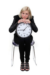 woman holding a huge clock