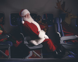 Santa Claus, elves, reindeer and presents on an airplane