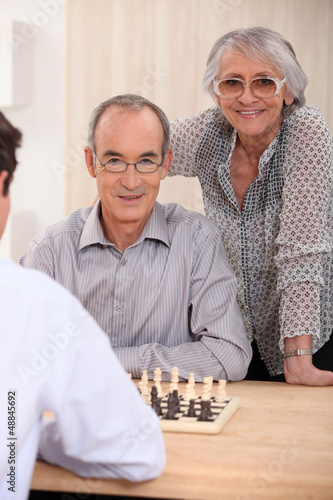 retired couple playing chess