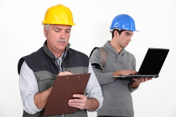 Builder stood with young apprentice