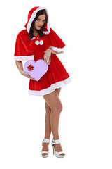 Sexy woman dressed as Mrs Claus with a heart-shaped box