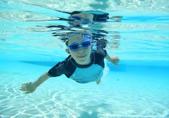 Boy swimming, underwater shot