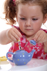 Girl with toy teapot
