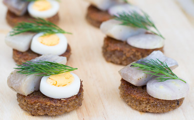 Close-up canapes with herring