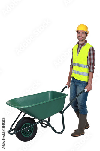 craftsman pushing a wheelbarrow