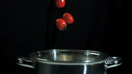 Red chili corn cob and tomatoes falling into pot