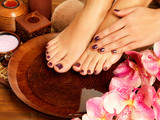 Fototapeta female feet at spa salon on pedicure procedure