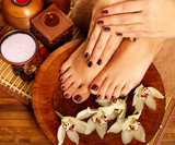 female feet at spa salon on pedicure procedure - 48850026