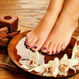 Fototapety female feet at spa salon on pedicure procedure