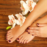 Fototapety female feet at spa salon on pedicure procedure